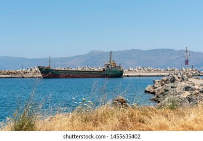 Kissamos Port, Kastelli, Crete, Greece. June 2019. The Syklark a general cargo ship alongside the harbour mole at Kissamos Port, Crete