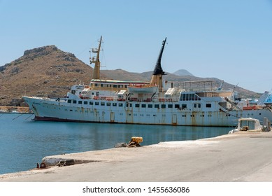 Kissamos Port, Kastelli, Crete, Greece. June 2019. An old ferry in a poor state of repair alongside and named Atlantis and Atlantic.
