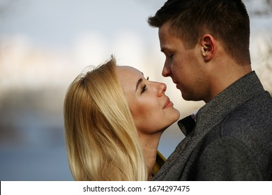 kisses of a couple in love in the park