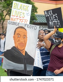 Kissimmee, Florida – June 2, 2020: Protesters gathered in downtown Kissimmee to show support for George Floyd. George Floyd died after a confrontation while in police custody.