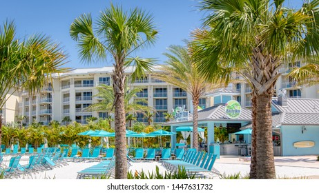 KISSIMMEE, FLORIDA - MAY 29, 2019: Margaritaville Resort Orlando. Main pool area with blue lounge chairs and Salty Rim bar & grill.