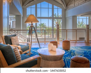 KISSIMMEE, FLORIDA - MAY 29, 2019: Margaritaville Resort Orlando. Seating lounge area in the main lobby with a Caribbean island theme overlooking the pool.