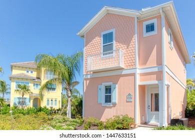 KISSIMMEE, FLORIDA - MAY 29, 2019: Margaritaville Resort Orlando. Peach and yellow caribbean island key west theme cottages for rent next to main hotel.