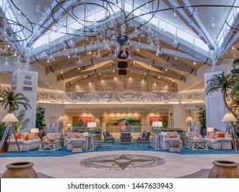 KISSIMMEE, FLORIDA - MAY 29, 2019: Margaritaville Resort Orlando, Florida. Indoor main lobby with tropical island theme, bright colors, and margarita glasses hanging from the ceiling.