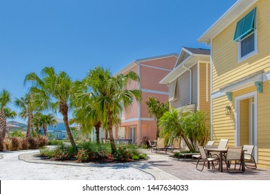 KISSIMMEE, FLORIDA - MAY 29, 2019: Margaritaville Resort Orlando. Colorful Caribbean themed cottages with back patios and white sand walkway.