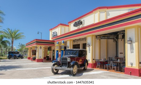KISSIMMEE, FLORIDA - MAY 29, 2019: Ford's Garage. Burgers and craft beer restaurant located in the shopping district of Sunset Walk near Margaritaville Resort Orlando. Featuring vintage cars.