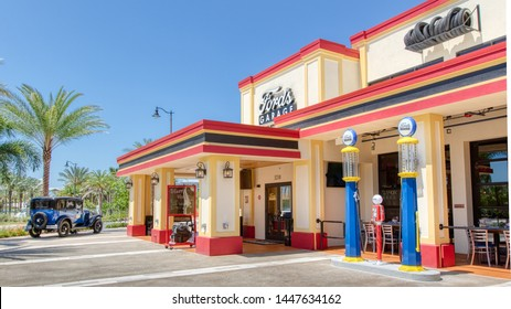 KISSIMMEE, FLORIDA - MAY 29, 2019:Ford's Garage. Restaurant serving burgers and craft beer in the shopping area of Sunset Walk near Margaritaville Resort Orlando. Featuring vintage cars