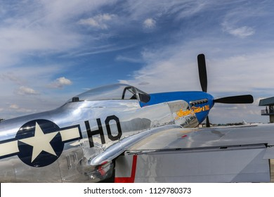 Kissimmee, Florida/USA - March 5, 2016: Closeup of Slender, Tender & TALL, a P-51 warbird, parked on the tarmac at Stallion 51, Kissimmee, Florida.