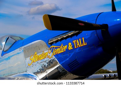 Kissimmee, Florida/USA - March 5, 2016: Closeup of Slender, Tender & TALL, a P-51D warbird, parked on the ramp at Stallion 51, Kissimmee, Florida. Focus on name on the nose. Blue sky and clouds.