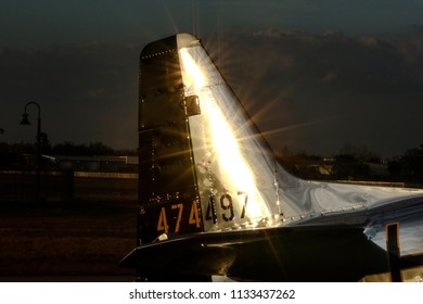 Kissimmee, Florida/USA - March 5, 2016: Closeup of sun flares reflecting off the tail section of The Little Witch, a P-51D Mustang warbird, parked on the tarmac at Stallion 51, Kissimmee, Florida.