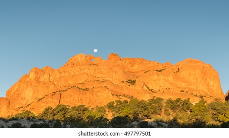 Kissing Camels (a named rock formation) under the harvest moon, in Garden of the Gods, Colorado Springs, Colorado.