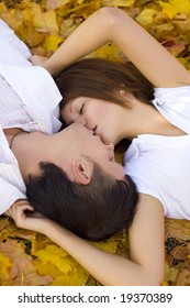 kissing couple in autumn park