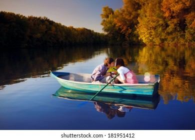 Kissing couple in a boat.