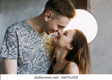Kissing couple portrait. Young couple deeply in love sharing a romantic kiss, closeup profile view of their faces