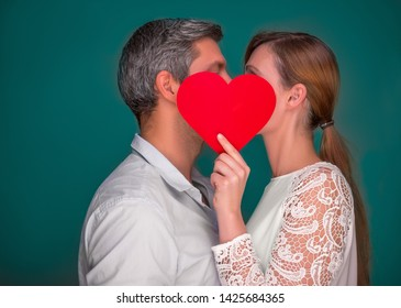 kissing love couple holding heart