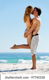 kissing summer beach couple on vacation in a tropical island scene