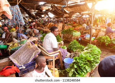 Kisumu, Kenya 4 28 2018: Local vendors selling vegetables at a market in Kenya,Africa