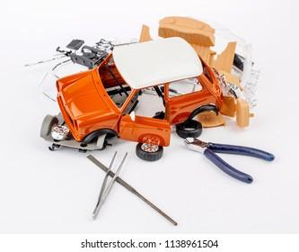 kit for assembling plastic car model on white background