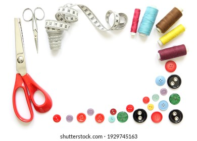 Kit design of sewing tools isolated on white background: spools of thread, needle, a pair of button scissors and a tape measure
