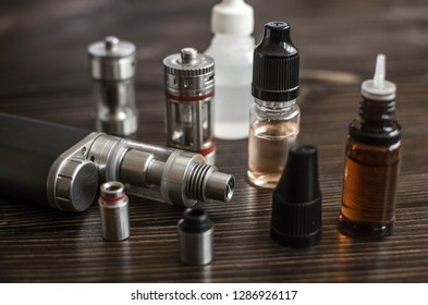 Kit for healthy smoking on wooden background, e-cigarette