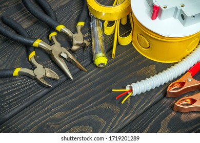 Kit spare parts and tools for electrical prepared before repair on black wooden boards