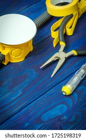 Kit spare parts and tools for electrical prepared before repair or setting on blue wooden boards