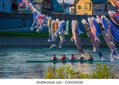 Kitakami,Iwate,Tohoku,Japan on April 26,2018:Carp streamers (or koinobori) and rowing boat at Kitakami River,Tenshochi Park.