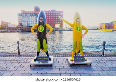 Kitakyushu ,Fukuoka ,Kyushu ,Japan - May 7th, 2018 : Banana Man Statue stands up in front of Retro High Mart Building which is famous photo spot in Mojiko Retro Town as mascot symbol in Moji Port.