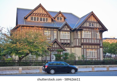 KITAKYUSHU, JAPAN - OCTOBER 31, 2013:  A large, stately Tudor style mansion from the nineteenth century stands beside a street in Kitakyushu, Japan.