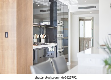 Kitchen accessories with modern look, luxury tools near oven, sink is attached to pantry, ceramic items on table.