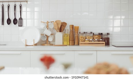Kitchen accessories, kitchen wood utensils in white kitchen room, ss