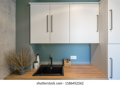 Kitchen area in studio apartments. The kitchen and dining room in a modern apartment.