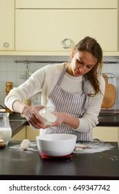 Kitchen baking dough, white flour woman housewife indoor