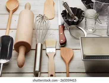 Kitchen baking utensils against white desk