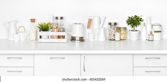 Kitchen bench full of various utensils isolated on white background