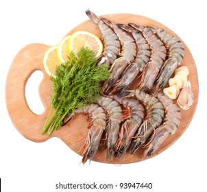 Kitchen Board with Tiger Prawns, Dill, Garlic and Lemon Isolated on white Background