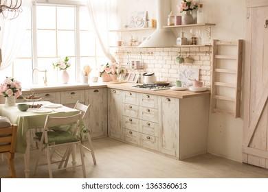 kitchen with bright fresh flowers. kitchen interior in green