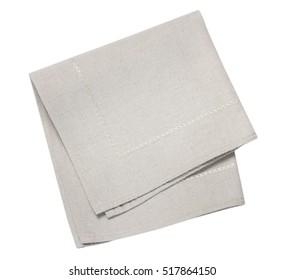 Kitchen burlap grey beige folded table cloth iolated on white background.