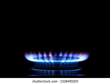 Kitchen burner flaming in the dark, closeup