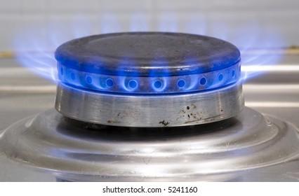 Kitchen burner on fire.