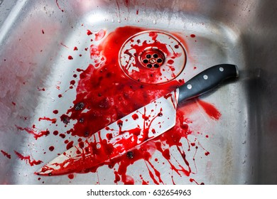 Kitchen Butcher Knife on Old Sink with Blood Splatters.