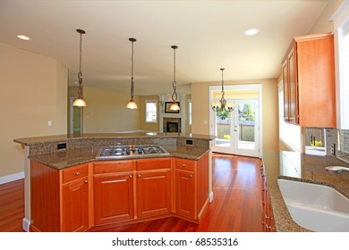 Kitchen with cherry cabinets and grey granite