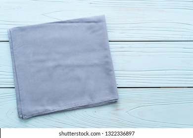 kitchen cloth (napkin) on blue wooden background with copy space