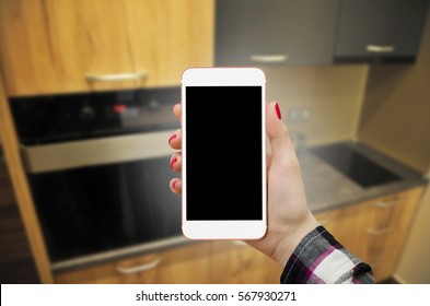 Kitchen concept mockup, women holding phone with empty display in hand