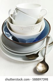 Kitchen cooking utensils. Cup and plate