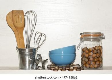 Kitchen cooking utensils on wooden shelf