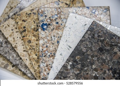 Kitchen counters and man maid stone countertops (or tiles) color samples, on white counter stone surface - can be used for display or montage your products