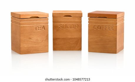 Kitchen craft natural elements acacia wood tea, coffee & sugar storage containers isolated on white background with shadow reflection. Wooden tea, sugar & coffee canister on white backdrop.