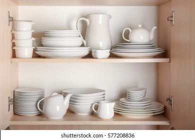 Kitchen cupboard with nice rustic dinnerware