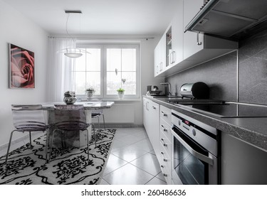 Kitchen currently at home with classical style, decorated in white with marble fittings 2